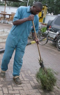 Kenyan man with Kenyan broom